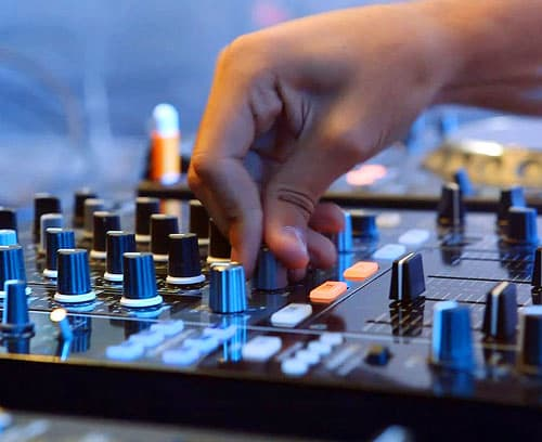 A man working on a soundboard.