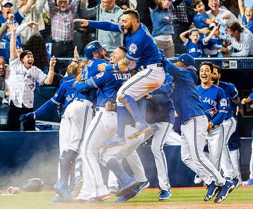 Toronto Blue Jays celebrate American League Division Series win at home base.