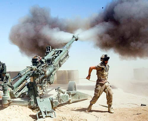 Gunner Jody Winsor, from Robert's Arm, Nfld., with the Canadian 2nd RCHA fires a 155mm howitzer in support of front line troops during a mission at the forward operating base in Helmand Province, Afghanistan