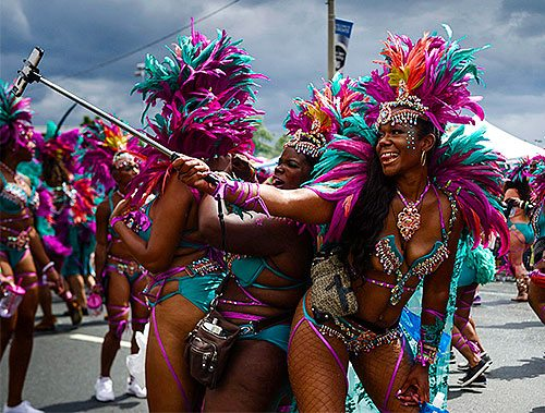 Parade participants taking a selfie during the Grand Parade at the Caribbean Carnival in Toronto.