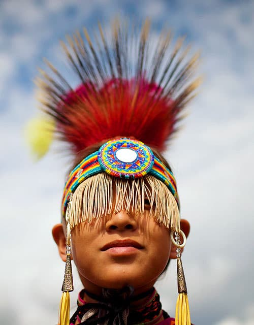a young boy in Native American dress