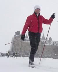 Senator Nancy Greene skies around the front lawn of the Parliament buildings during an event promoting the National Health and Fitness day in Ottawa.