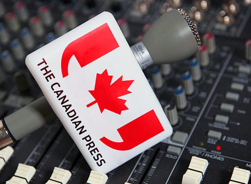 A microphone with The Canadian Press logo.