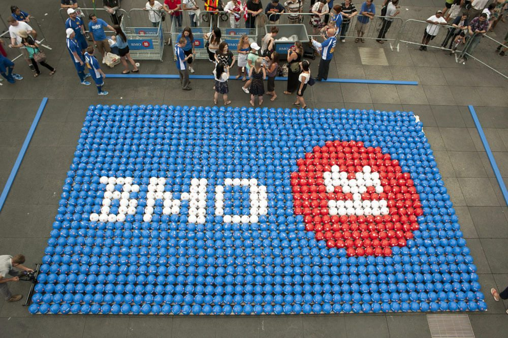 Corporate: We did it!! Toronto is the new home of the Guinness World Record for the largest soccer ball mosaic ever assembled. Residents and visitors carefully placed 1,288 soccer balls in place to build a giant BMO logo in Toronto, Thursday, July 5, 2012. MARKETWIRE PHOTO/BMO Bank of Montreal
