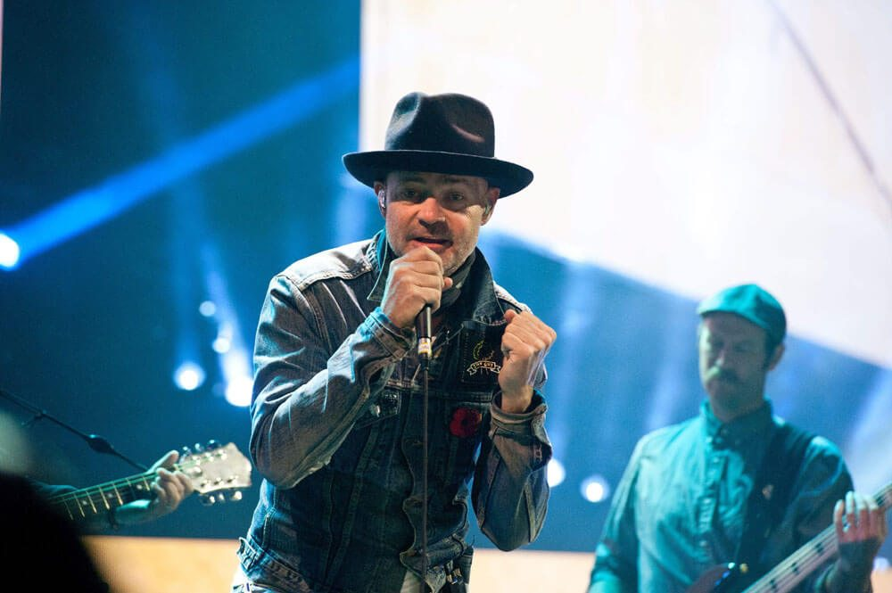 Event: Singer, songwriter, poet and actor, Gord Downie, performs for 20,000 students and educators at WE Day Toronto at the Air Canada Centre on Wednesday, October 19, 2016. MARKETWIRED PHOTO/WE Day