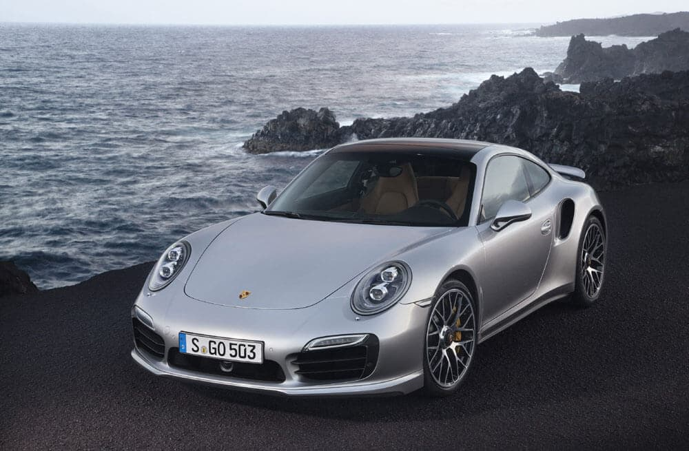 2014 911 Turbo S. parked near an ocean.