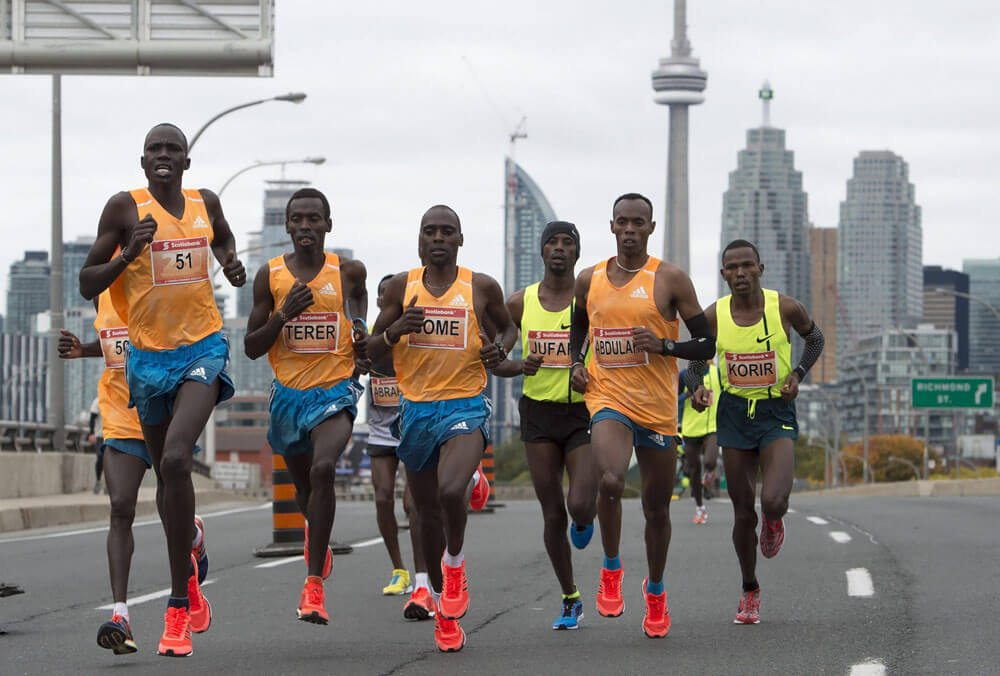 Sports: Leading men setting the pace at the 25th anniversary of the Scotiabank Toronto Waterfront Marathon, Sunday, October 19, 2014, in Toronto. MARKETWIRED PHOTO/Scotiabank