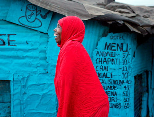 A woman wearing a red garb in Kenya.