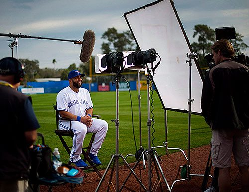 Blue Jay player being interviewed on a baseball field.
