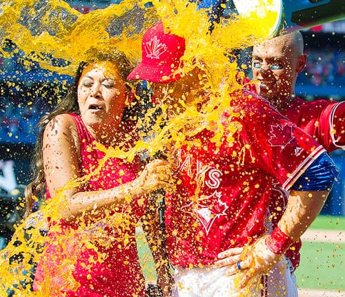 Toronto Blue Jays Steve Pearce and Sportsnet's Hazel Mae get a gatorade shower from Blue Jay teammates.