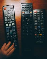 Three remote television remote control devices.