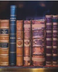 Old books on a bookshelf.