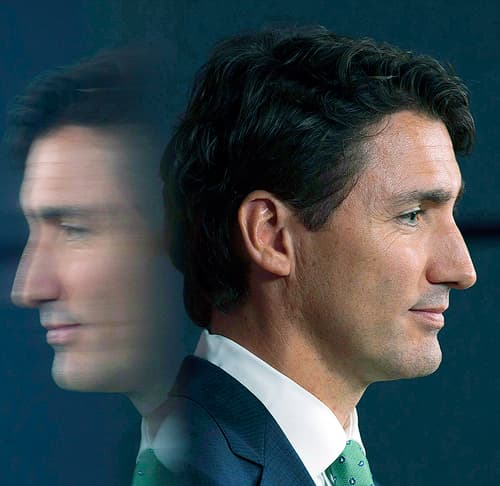 Profile picture of Justin Trudeau with a mirror reflection behind him.