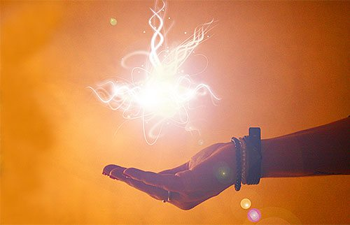A hand holding a flash of light.
