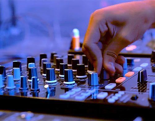 Man working on a sound board.