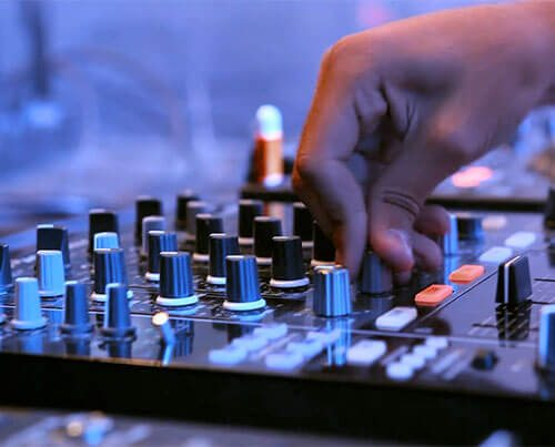 A man operating a mixing sound board.