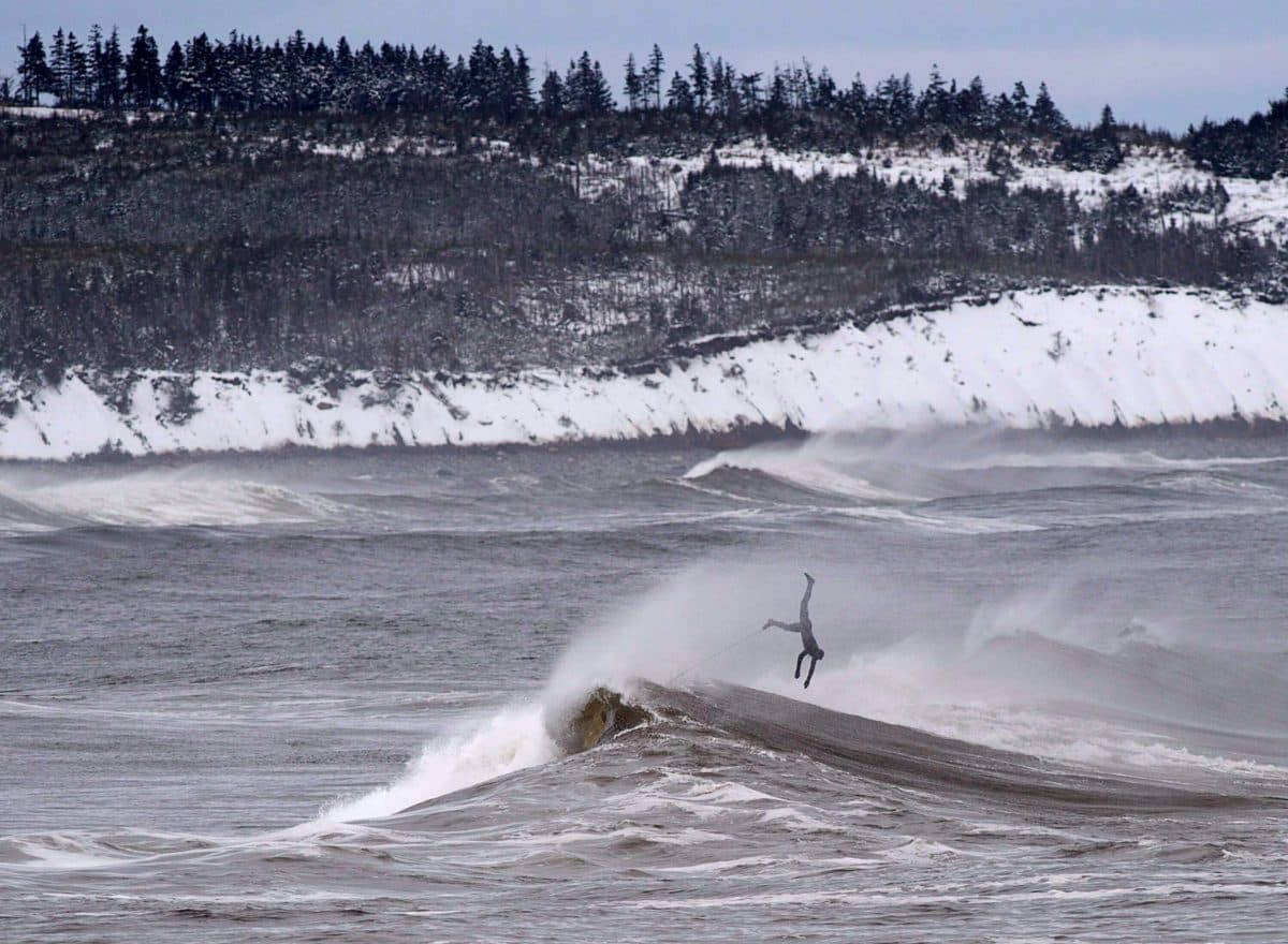 A surfer comes off a wave in Cow Bay, Nova Scotia.