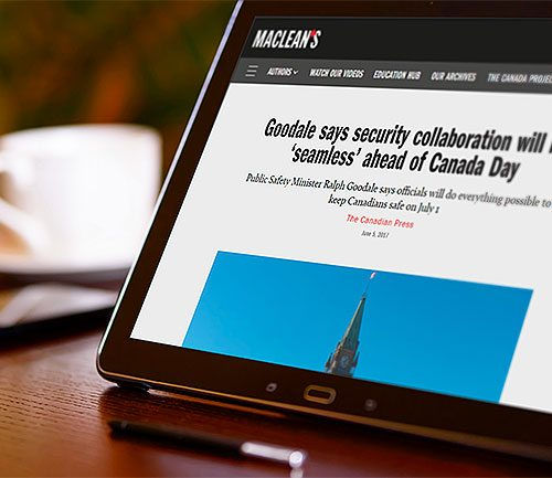 Article by The Canadian Press on Maclean's website displayed on tablet screen.