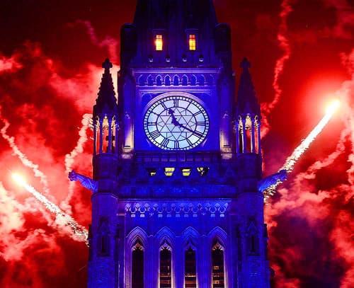 Fireworks display behind Parliament building.