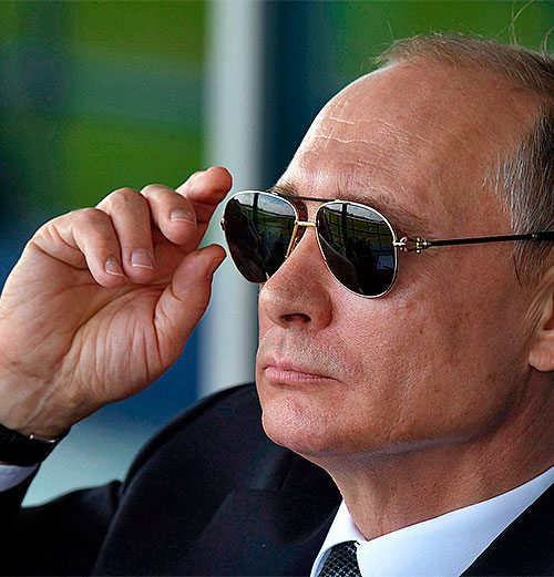 Vladimir Putin wearing dark sunglasses