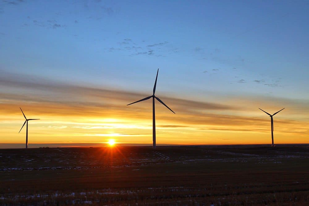 Windmills in a faded light landscape