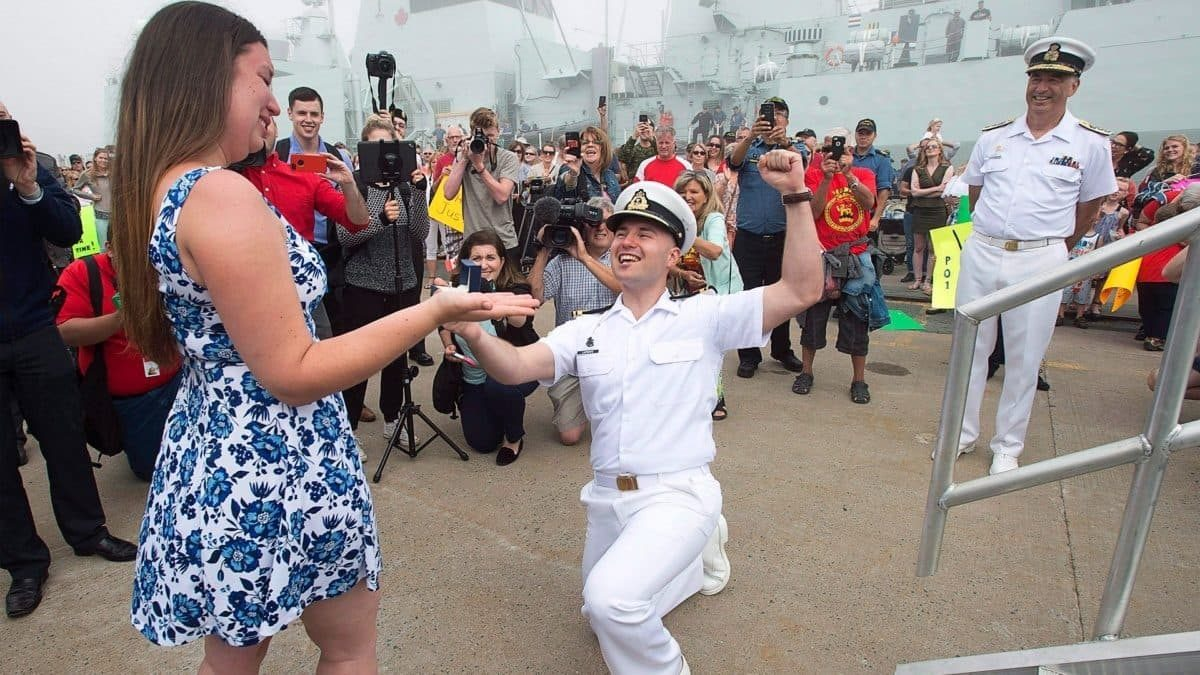 a sailor reacting after his girlfriend accepted his marriage proposal
