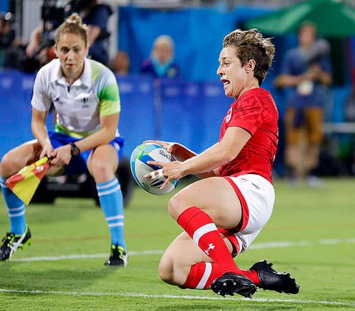 Canada's Ghislaine Landry scores a winning try during the women's rugby sevens quarter final match against France