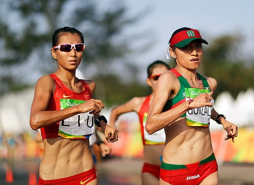 "Mexico's Maria Guadalupe ""Lupita"" Gonzalez, right, competes in the women's 20-km race walk"