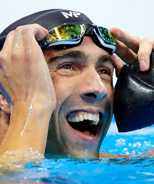 United States' swimmer Michael Phelps reacts after the men's 100-meter butterfly final