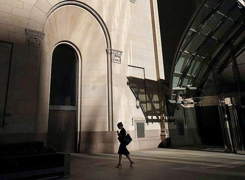 A woman walks through Toronto's financial district.