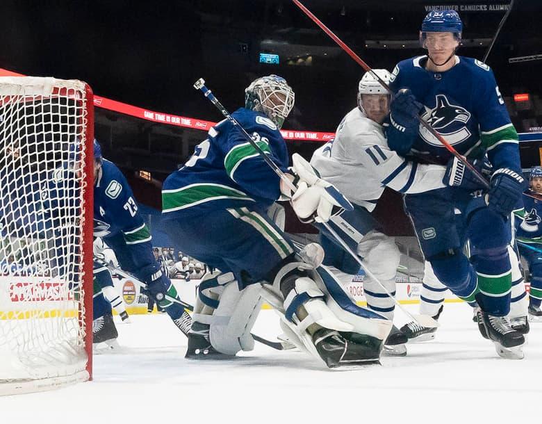 Virtanen scores twice, Canucks snap Leafs' win streak