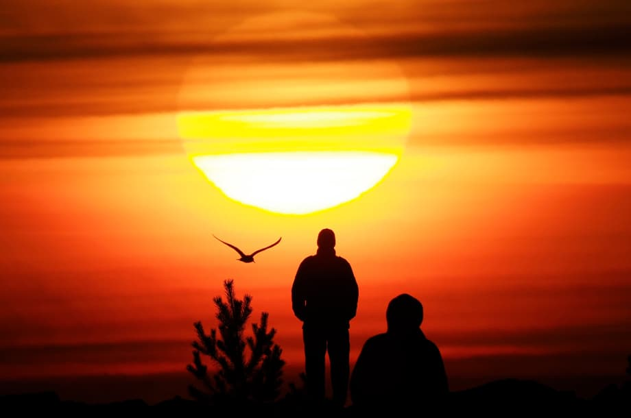 People watch the sunset over the Finnish Gulf coast in St. Petersburg, Russia, Wednesday, April 14, 2021. (AP Photo/Dmitri Lovetsky)
