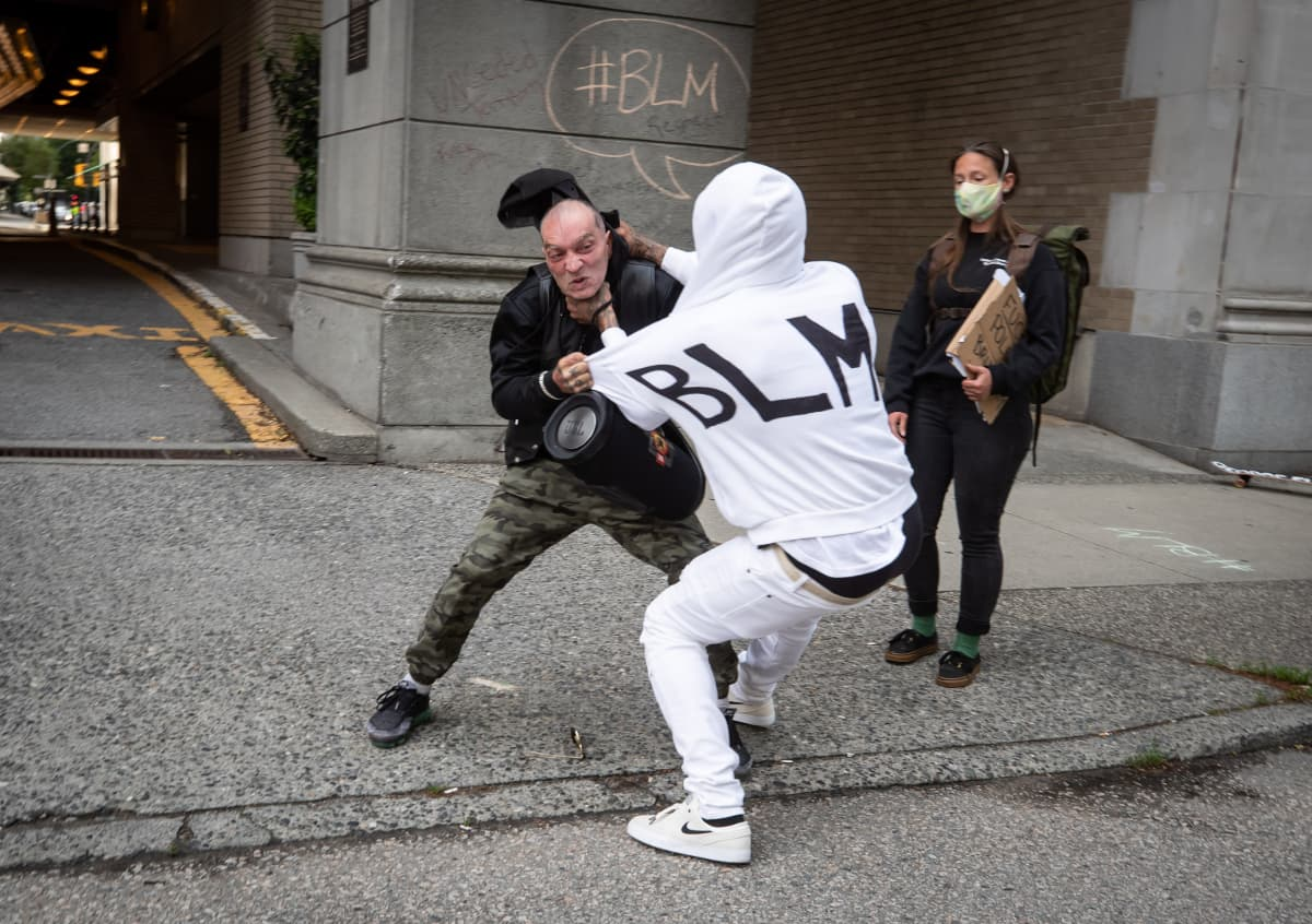 two men clashing at a Black Lives Matter protest in Vancouver