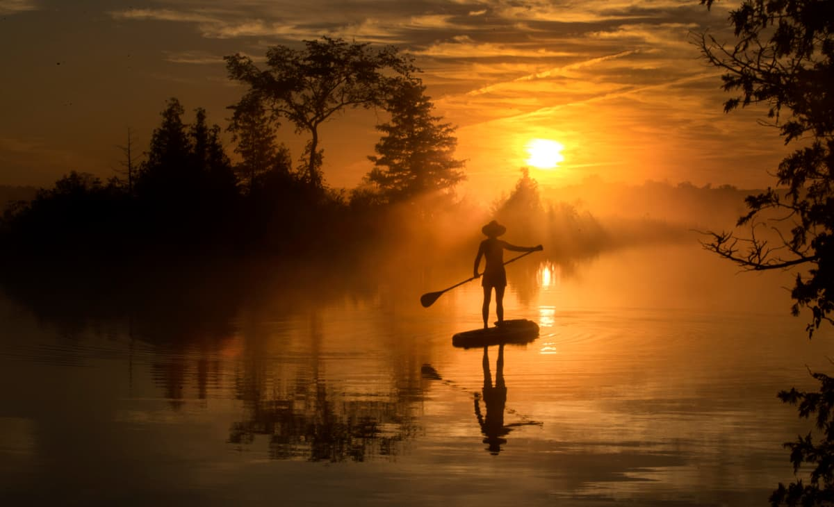 a paddleboarder out for an early-morning paddle on the Trent-Severn waterway