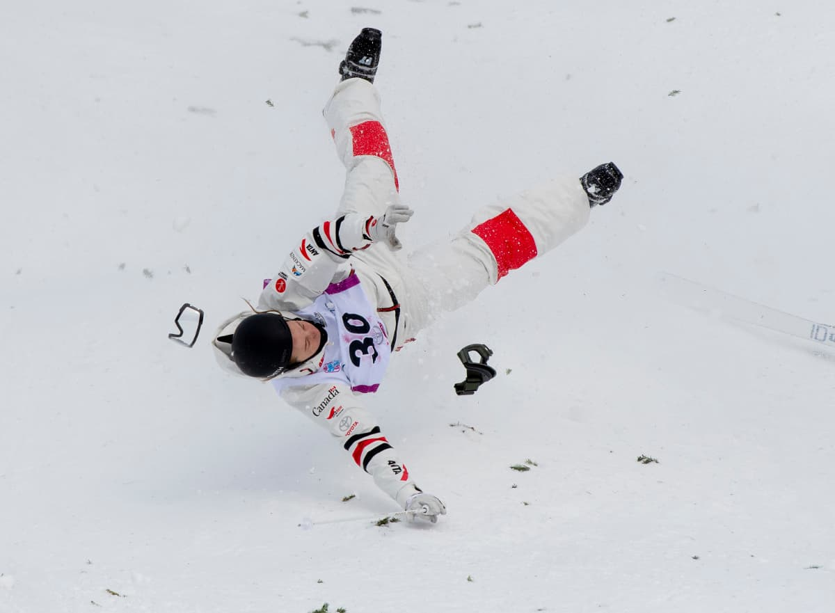 a freestyle skier tumbling to earth after a jump went wrong