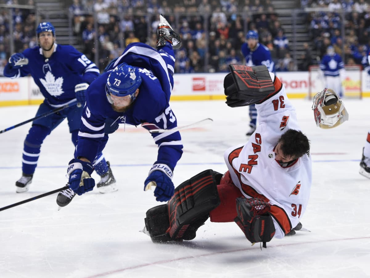 a collision between a Toronto Maple Leafs player and a Carolina Hurricanes goaltender